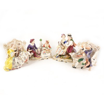 Lot 1032-Four Continental porcelain figures, including pair of seted musicians