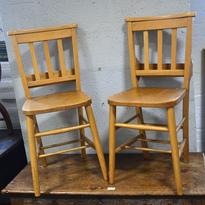 Lot 59-A set of eleven beech and mixed wood Chapel chairs