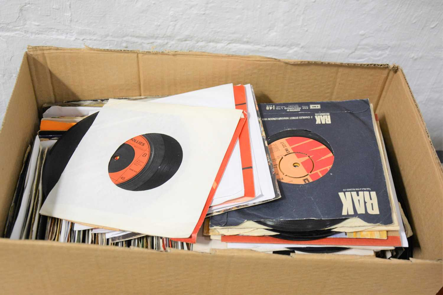 """Lot 41-A box of aprox 250 mixed 7"""" single records, including The Hollies, Lulu, Abba, Dexys Midnight Runners, Ian Matthews, ELO etc."""