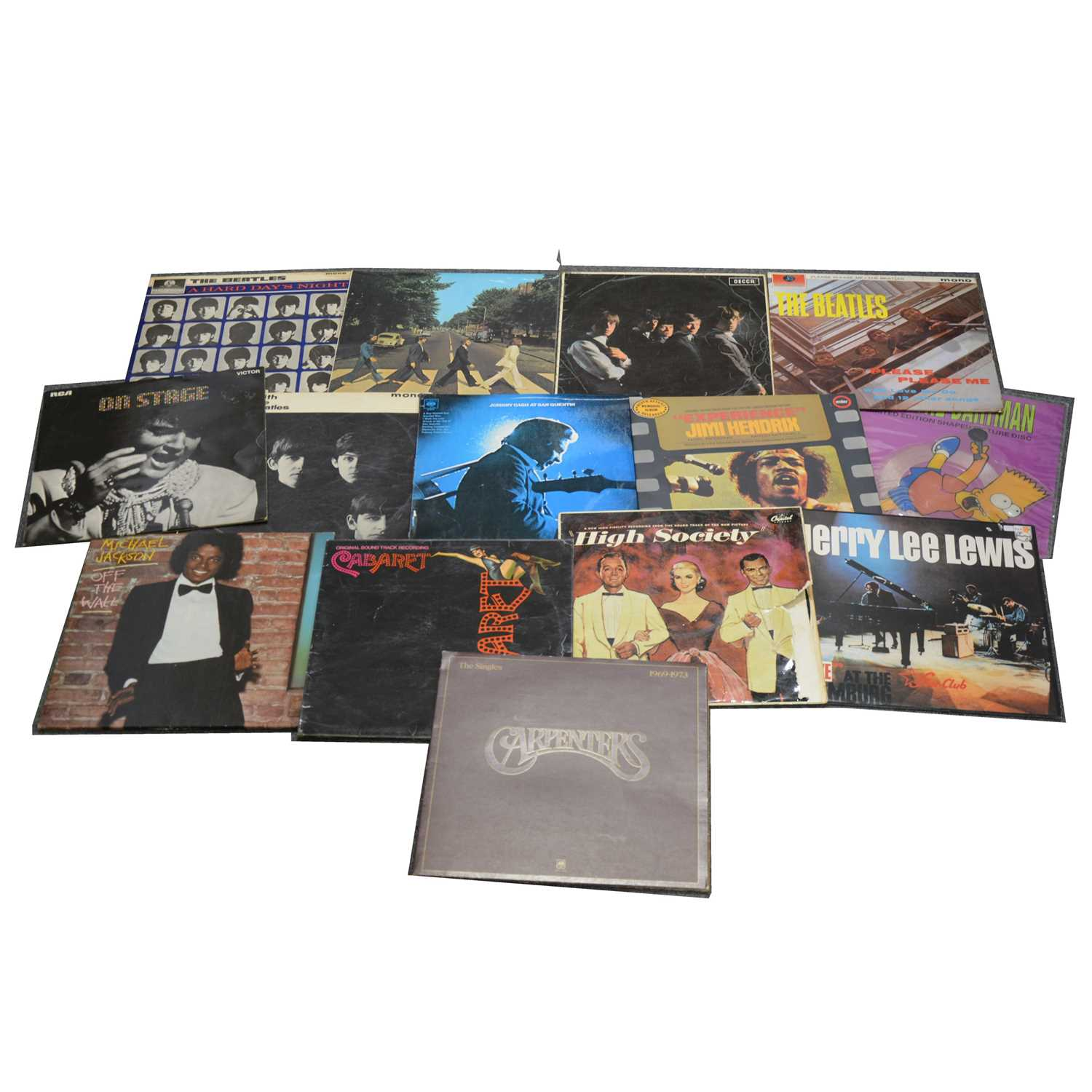 """Lot 24-Small collection vinyl records, including The Beatles, The Rolling Stones and a small quantity of 7"""" singles."""
