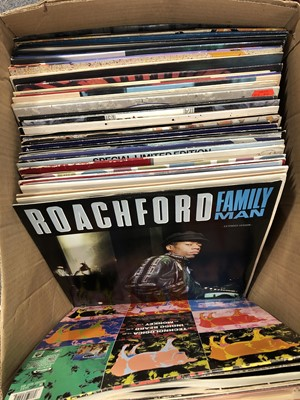 """Lot 39-Two boxes of aprox 237 12"""" single vinyl records; including David Bowie, Simple Minds, etc"""