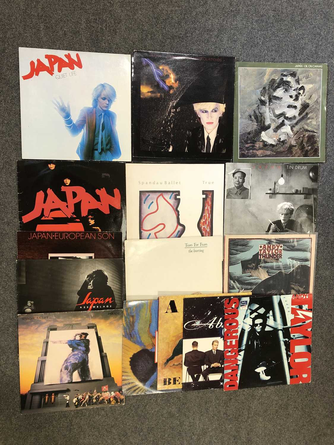 """Lot 33-Sixteen LP and 12"""" single vinyl records; including six albums by Japan"""