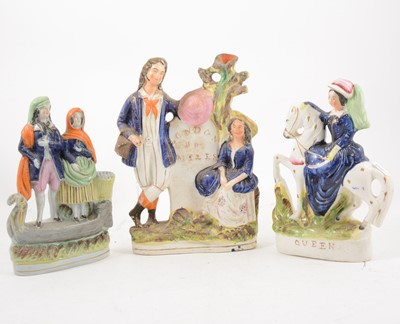 Lot 1054-Fourteen Staffordshire figures and spill vases