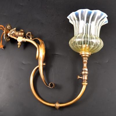 Lot 520-An English Edwardian brass and opalescent glass wall light