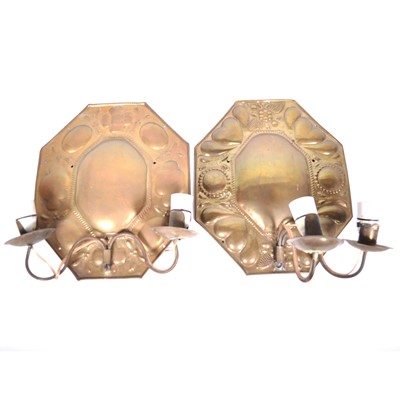 Lot 518-Two similar Arts and Crafts brass wall sconces