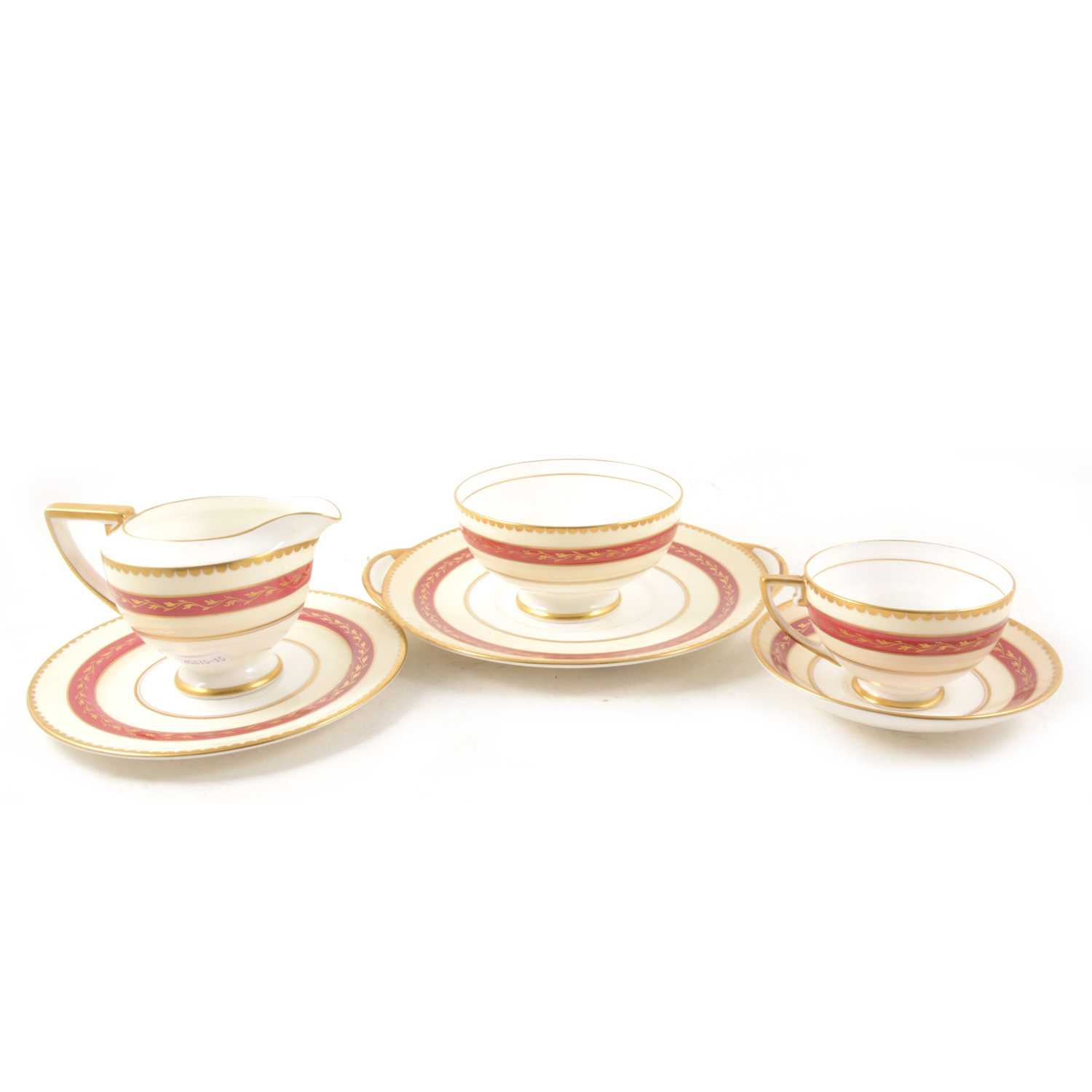 Lot 20-Royal Doulton bone china teaset, cream and red banded, with gilt.