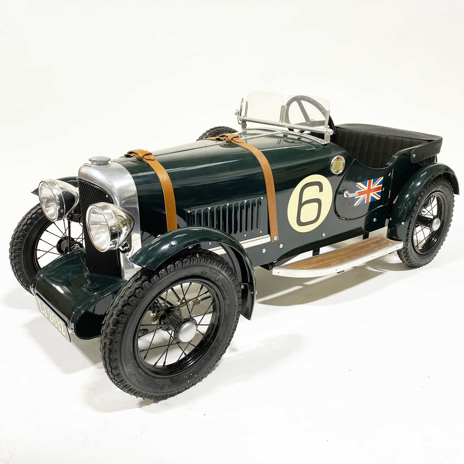67 - A Bentley Speed 6 pedal car; 1.5m in length, painted with British racing green, no.6 side decals