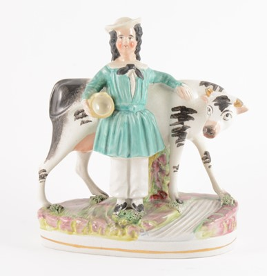 Lot 10-A Staffordshire group of Cow and Milkmaid