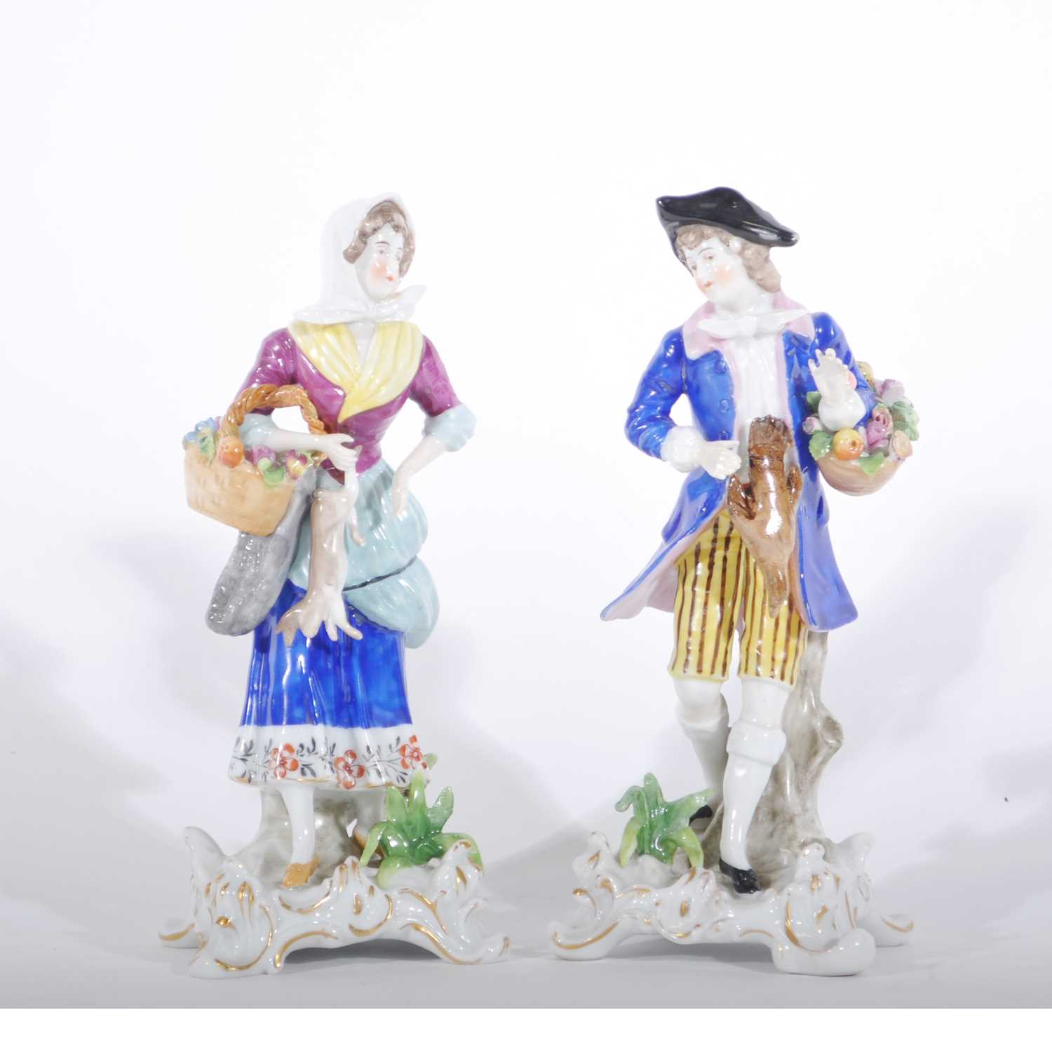 Lot 29-Pair of Continental porcelain figures, with game and flower baskets