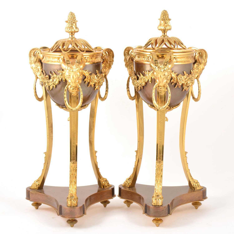 Lot 41-A pair of Louis XVI style bronzed and gilt metal cassolettes en athénienne