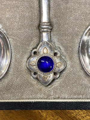 Lot 525-A cased set of six Arts and Crafts silver cabochon set teaspoons, by Harold Edwin Landon of Lancaster