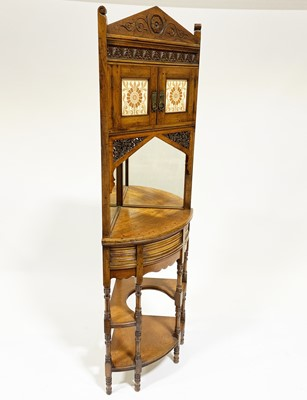Lot 503-An Indian hardwood and tiled corner cabinet in the Gothic Revival taste
