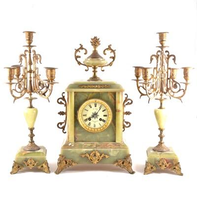 Lot 109 - French onyx and gilt metal three-piece clock garniture