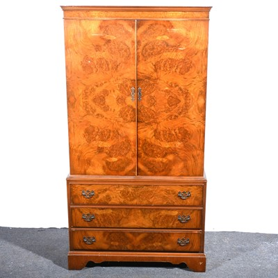 Lot 50 - A reproduction figured walnut cabinet.