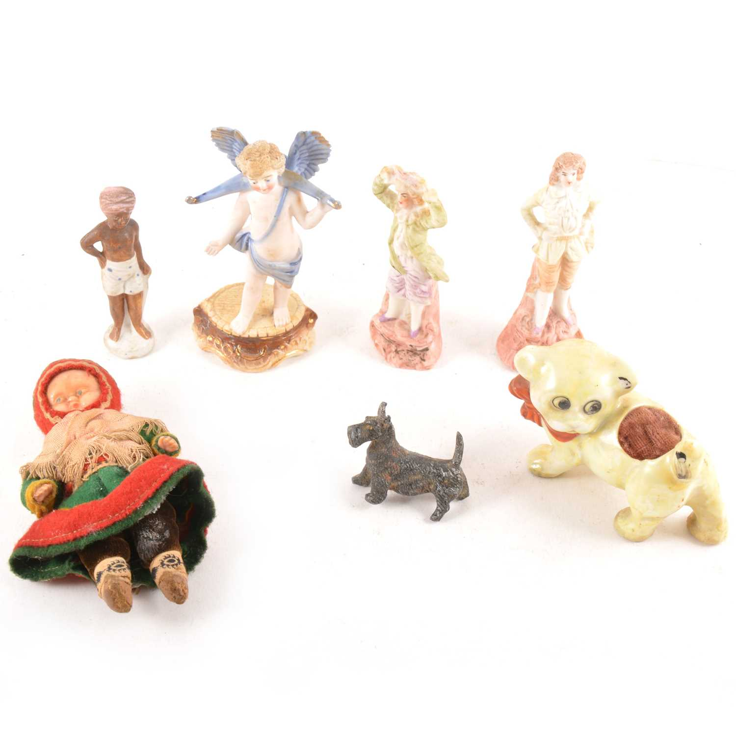Lot 34-A collection  of small bisque figures and miniature doll figures, early plastic animals.