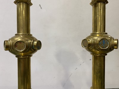 Lot 34-A pair of Victorian Gothic Revival brass altar candlesticks, probably to a design by A.W.N. Pugin