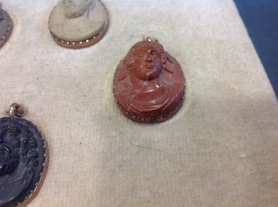 Lot 42-A collection of eight lava portrait cameos