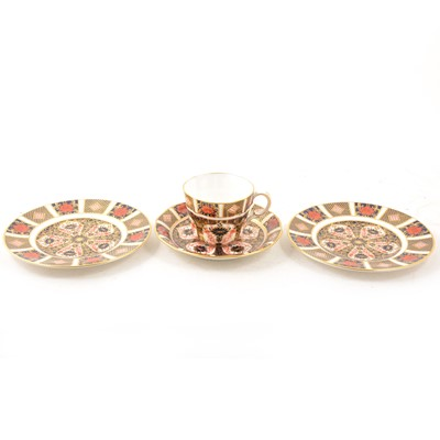 Lot 9 - Royal Crown Derby - Old Imari pattern trio and another tea plate