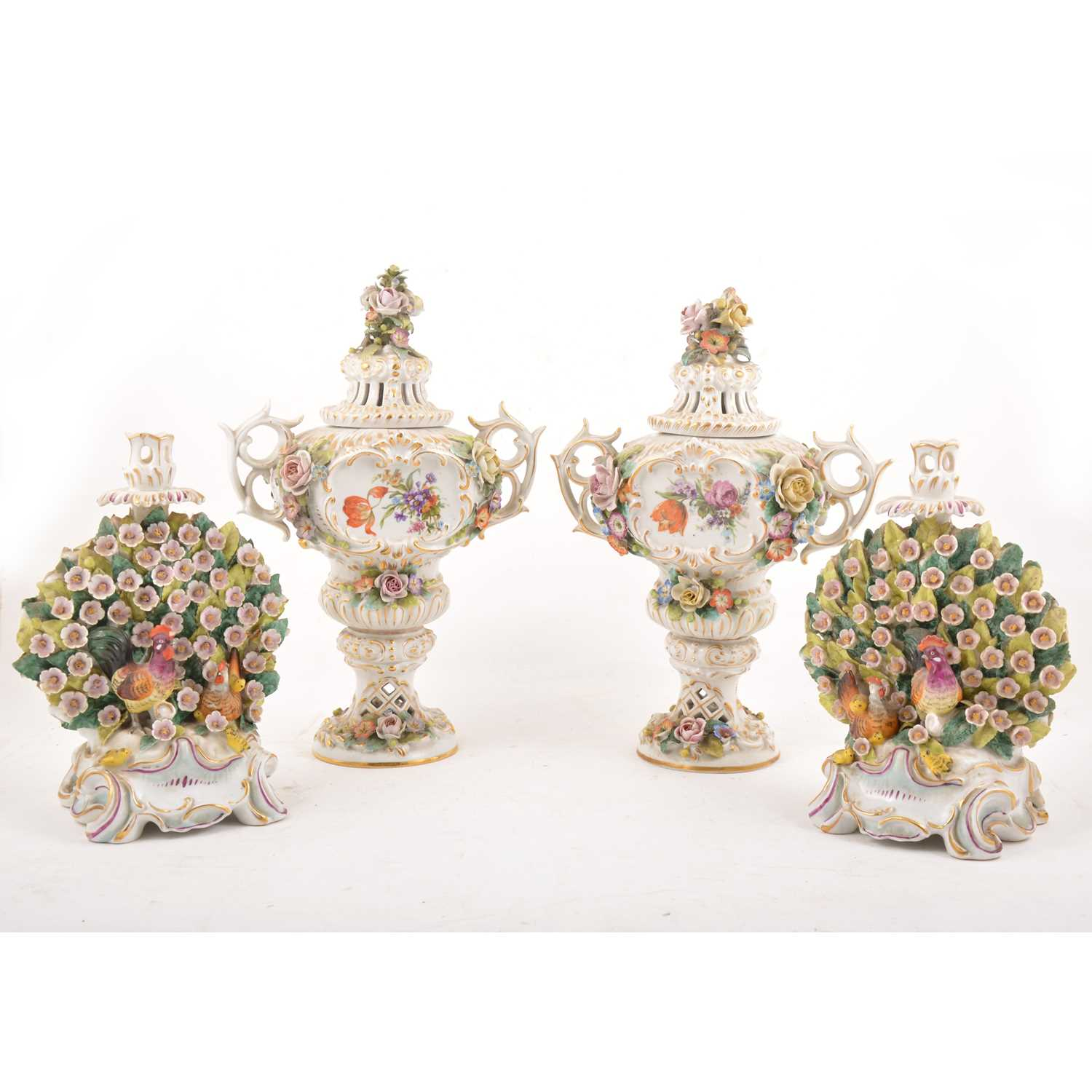 Lot 35 - Pair of Continental vases and covers, and a pair of Chelsea style bocage candlesticks