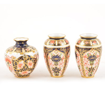 Lot 13 - A pair of Royal Crown Derby Imari design miniature ovoid vases, and a miniature swollen vase.