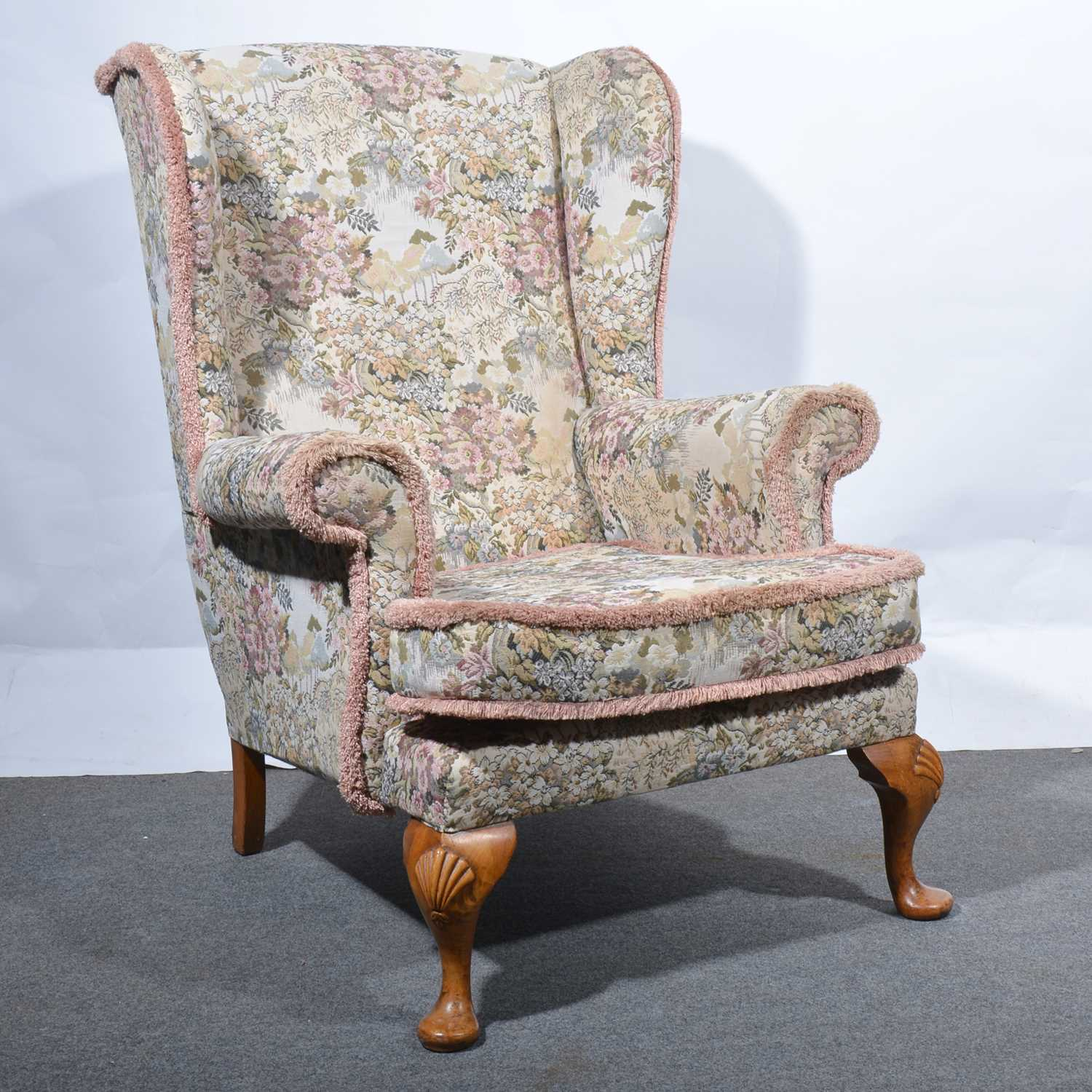 Lot 32 - A Georgian style wing-back chair.