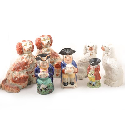Lot 48 - Three Staffordshire Toby jugs and two pairs of King Charles Spaniels.