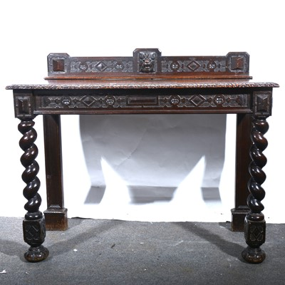 Lot 39 - A carved and stained oak hall table.