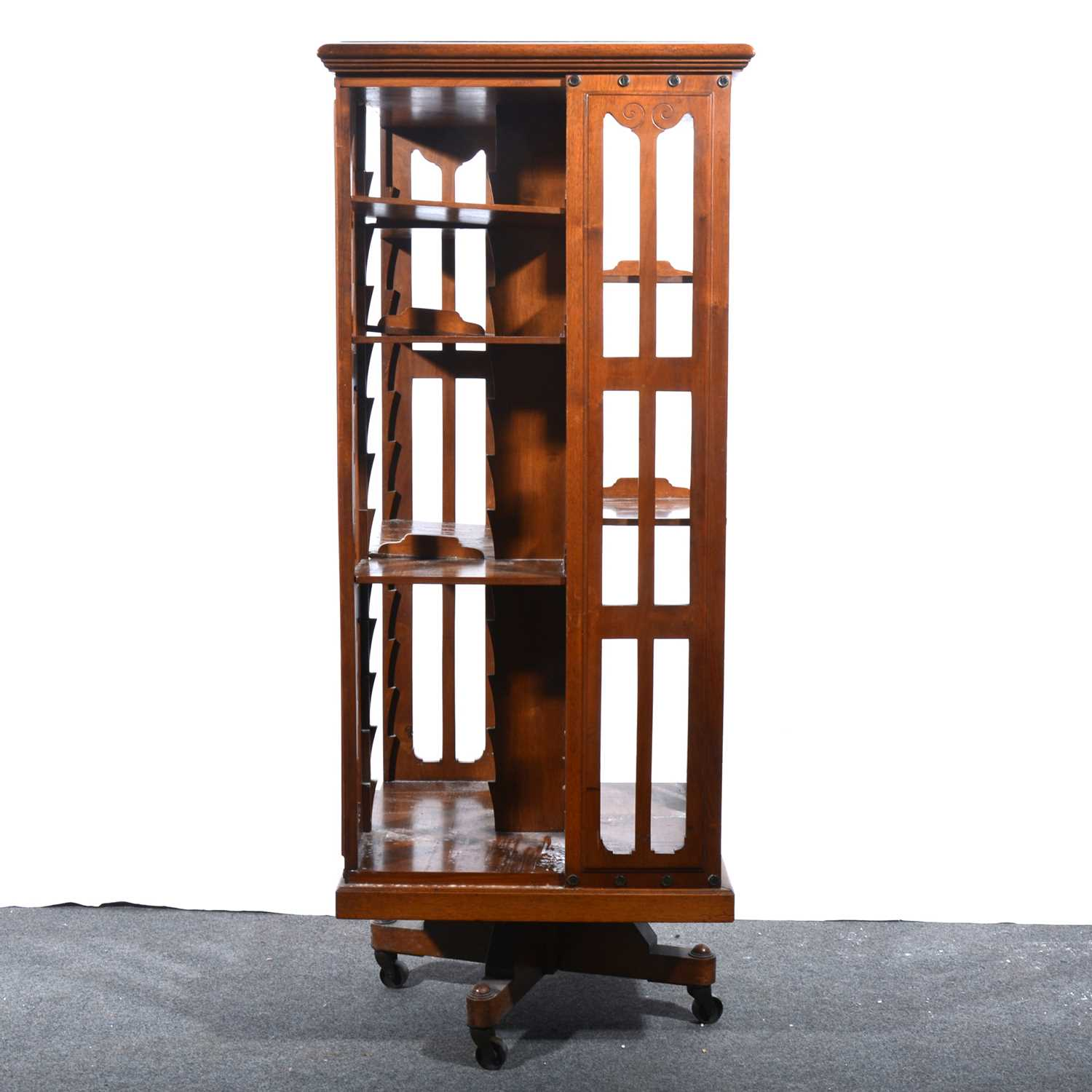 Lot 46 - An Edwardian walnut revolving bookcase.