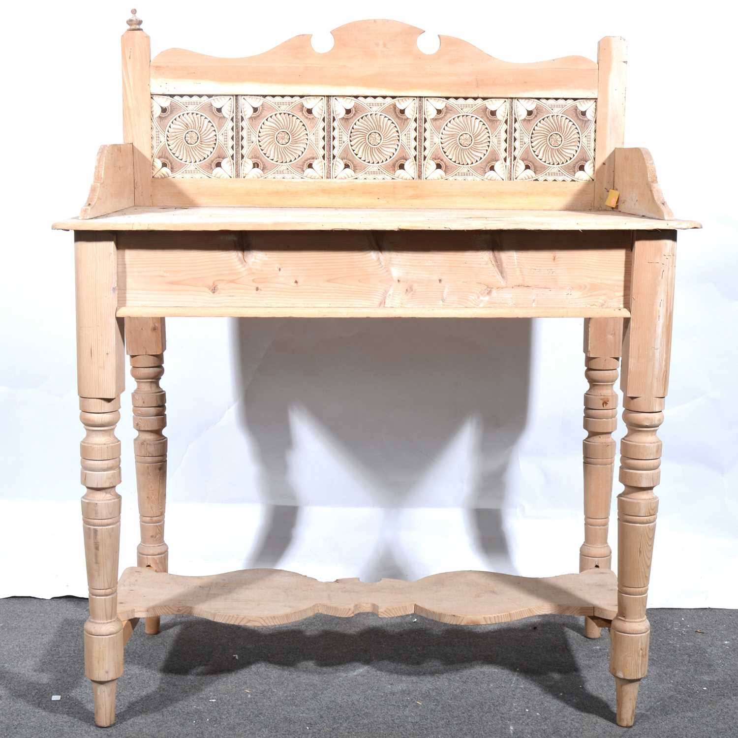 Lot 6 - A stripped pine washstand with tile back.