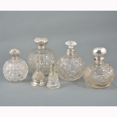 Lot 18-Six cut-glass cologne and scent bottles.
