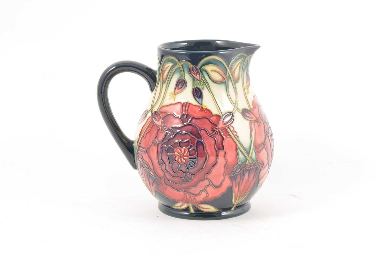 Lot 52 - A Moorcroft Pottery 'Eustoma' jug, designed by Carole Lovatt