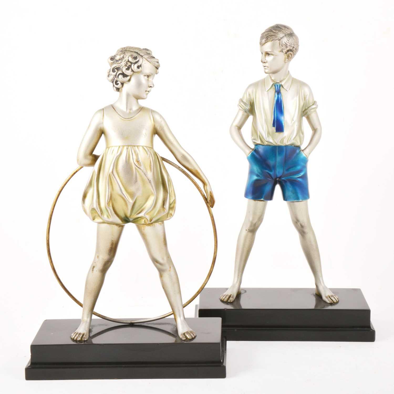 Lot 39-Ferdinand Preiss, 'Sonny Boy' and 'Hoop Girl' a large pair of Art Deco bronze figures
