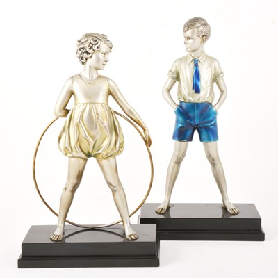 Lot 39-Ferdinand Preiss, 'Sonny Boy' and 'Hoop Girl' a large pair of Art Deco bronze figures