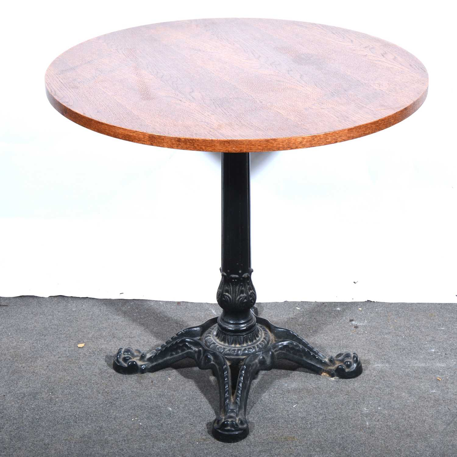 Lot 24 - A reproduction cast iron pub table, and an oak stool.