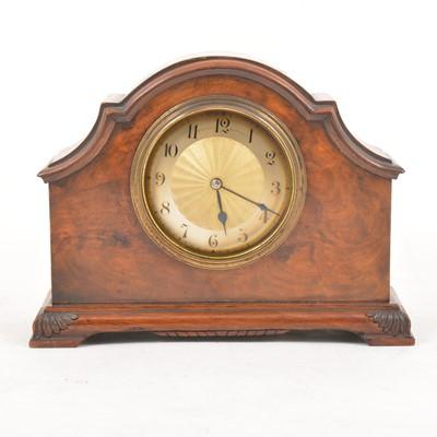 Lot 114 - A walnut and brass mantel clock