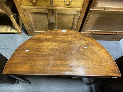 Lot 15 - A George III mahogany demi lune tea table.