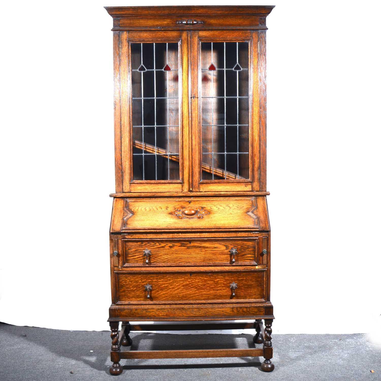 Lot 9 - An oak bureau bookcase.