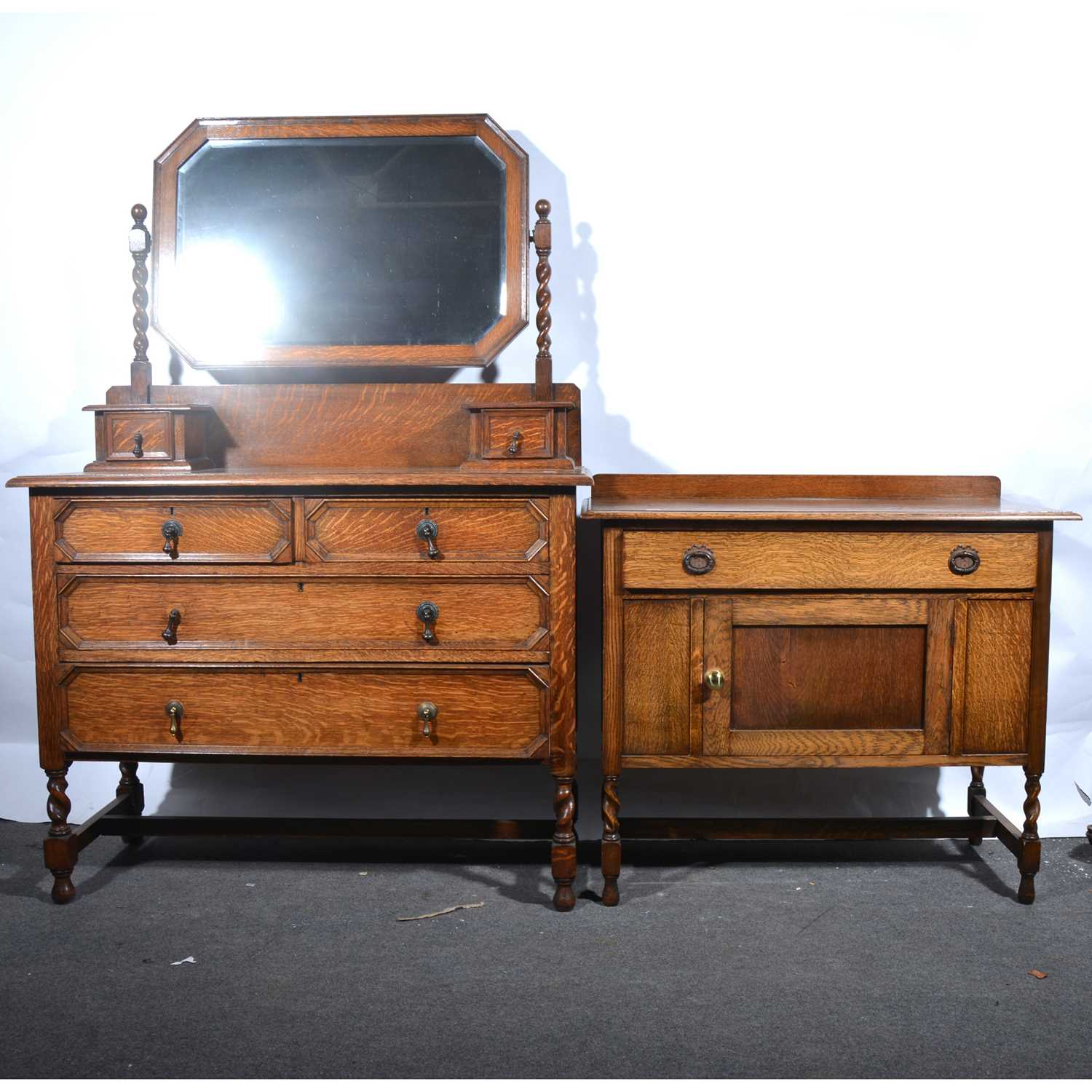 Lot 30 - An oak dressing table and similar washstand.