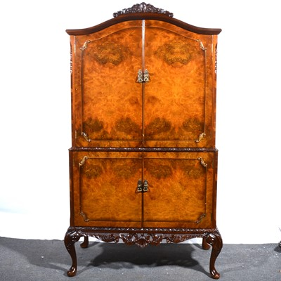 Lot 48 - A reproduction burr walnut cocktail cabinet, Queen Anne style.