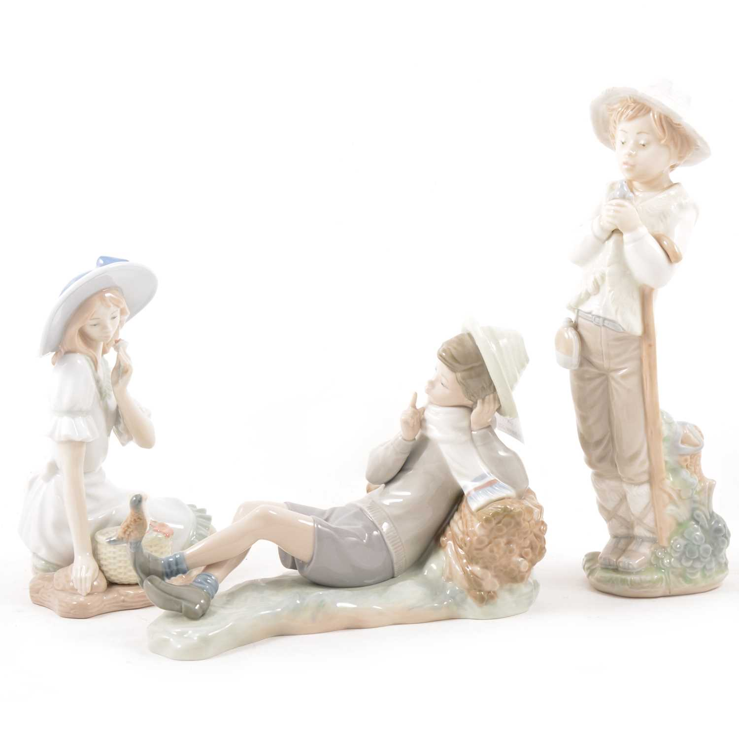 Lot 42 - A Lladro porcelain figure and two Nao porcelain figures