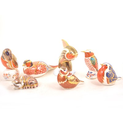 Lot 3 - Royal Crown Derby - A collection of seven paperweights, plus a trinket box.