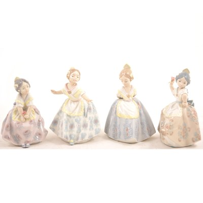 Lot 16 - A set of four small Lladro figures of girls.