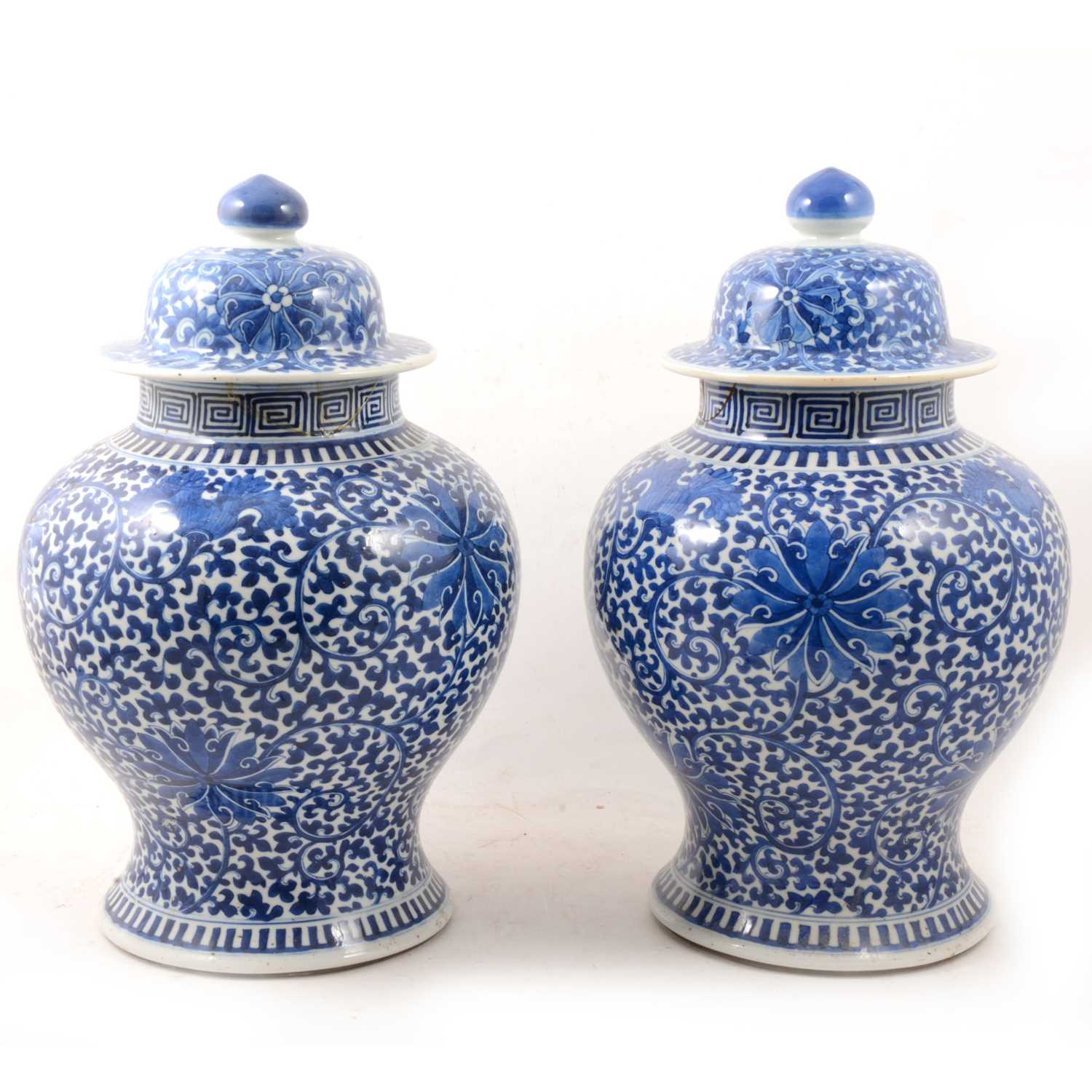 Lot 1 - A pair of Chinese blue and white covered vases