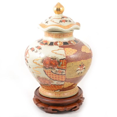Lot 36 - A large Oriental covered storage jar.