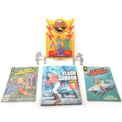 Lot 19 - Flash Gordon interest, a selection of publications and books, figures and comics.