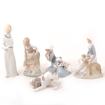 Lot 10A - Four Lladro figures and another figure.