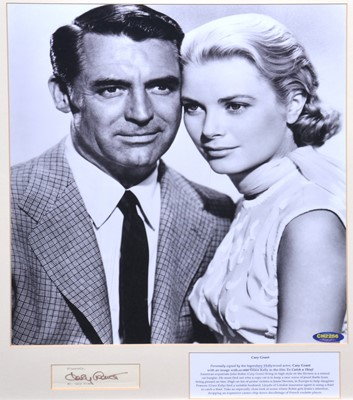 Lot 5 - Cary Grant, signed letter cutting, framed and mounted with photo with Grace Kelly