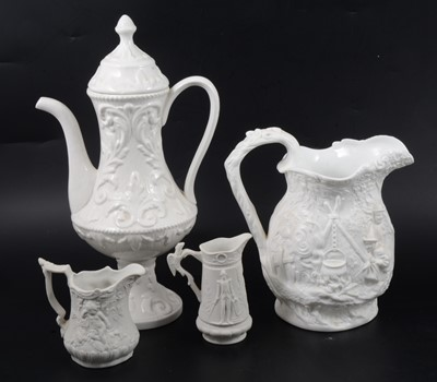 Lot 21 - A Samuel Alcock & Co white stoneware jug, plus other white pottery items.
