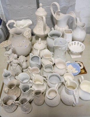 Lot 21 - A Samuel Alcock & Co white stoneware jug, plus other white pottery items.