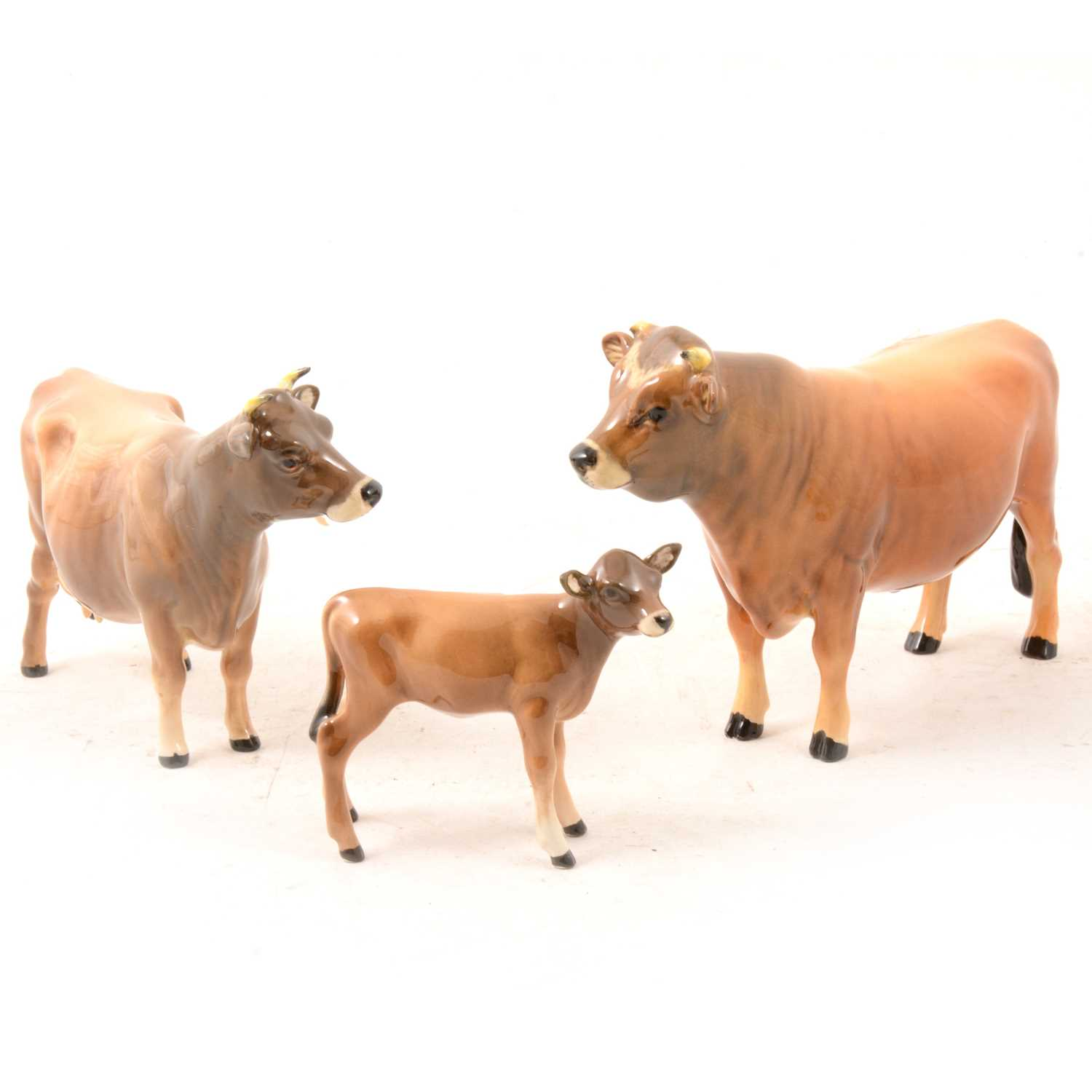 "Lot 7 - A Beswick Jersey Bull ""Ch. Dunsley Coy Boy"", Cow ""Ch. Newton Tickle"", and Calf models."